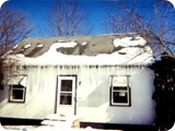 Major Ice Dams On The Front Of An Existing Older Home