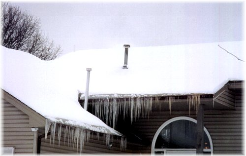 Major Ice Dams Formed Along Roofline