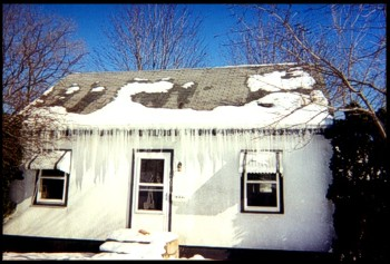 This Home Has Major Ice Dams That Are Blocking The Front Entrance To The Home